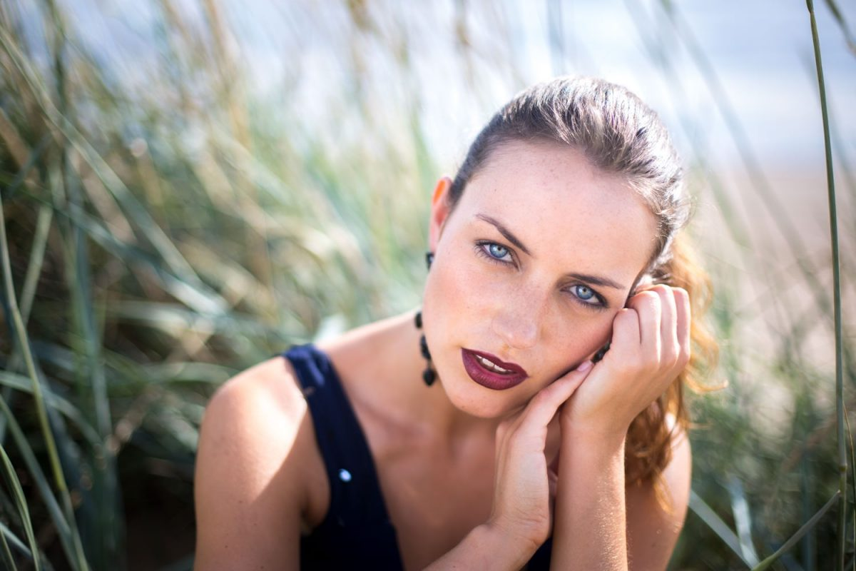 fashion makeup artist photo of model in sand dunes